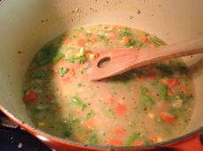 Add the stock. And frozen veggies.
