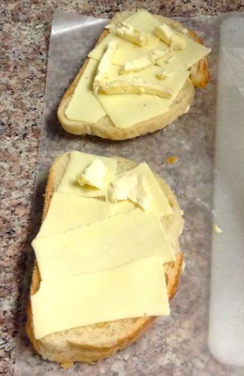 Buttered Italian bread with American cheese and Saint André...