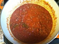 After simmering, before cheese and fresh basil
