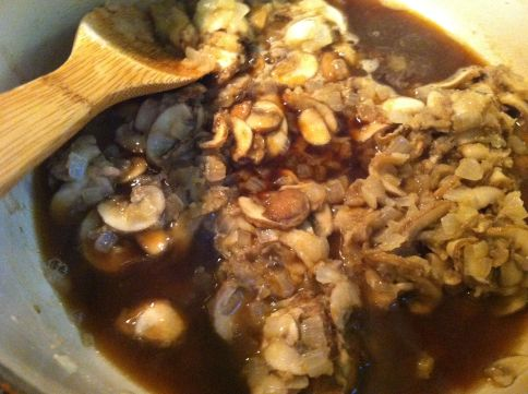 Add the porcini mushroom broth and soy sauce